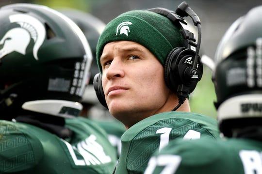 Injured MSU quarterback Brian Lewerke looks on during Saturday's game against Purdue.