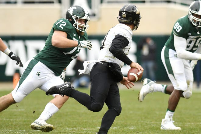 Michigan State's Mike Panasiuk, left, pressures Purdue's David Blough during the second quarter on Saturday, Oct. 27, 2018, at Spartan Stadium in East Lansing.