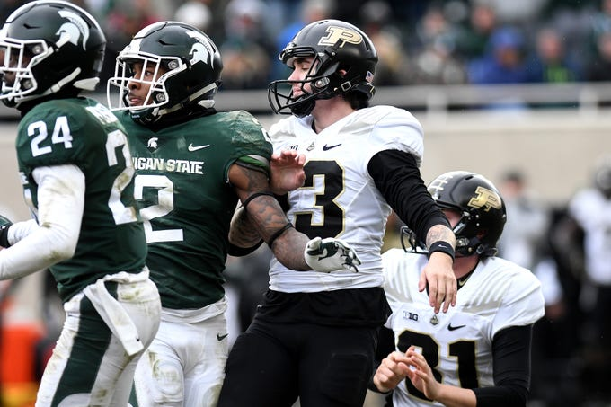 Purdue's kicker Spencer Evans, center, reacts after his field goal attempt that would have tied the game was blocked during the fourth quarter on Saturday, Oct. 27, 2018, at Spartan Stadium in East Lansing.