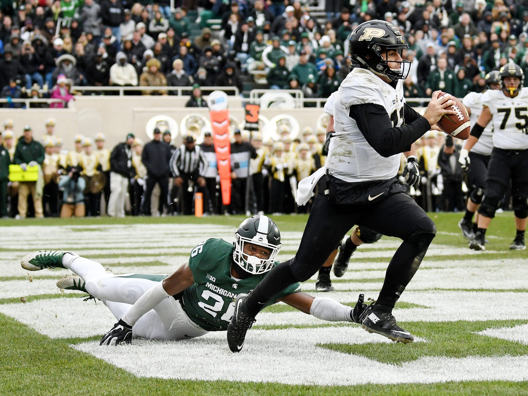 Michigan State's Brandon Bouyer-Randle, left, pressures Purdue quarterback David Blough as he scrambles in the end zone during the third quarter on Saturday, Oct. 27, 2018, at Spartan Stadium in East Lansing.