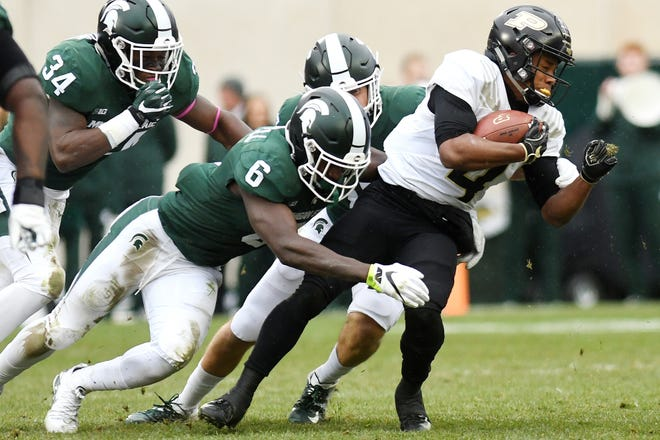 Michigan State's David Dowell, left, tackles Purdue's Rondale Moore during the second quarter on Saturday, Oct. 27, 2018, at Spartan Stadium in East Lansing.