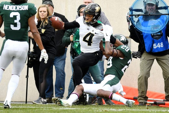 Michigan State's Shakur Brown, right, tackles Purdue's Rondale Moore during the first quarter on Saturday, Oct. 27, 2018, at Spartan Stadium in East Lansing.