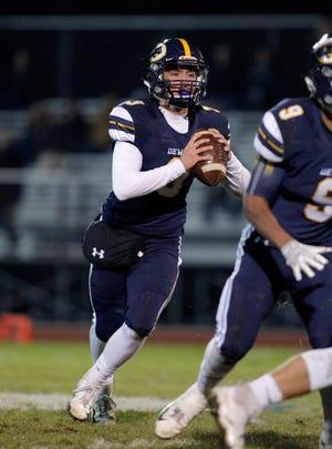 DeWitt quarterback Blake Gatfield looks to throw against St. Johns, Friday, Oct. 26, 2018, in DeWitt, Mich. DeWitt won 34-7.