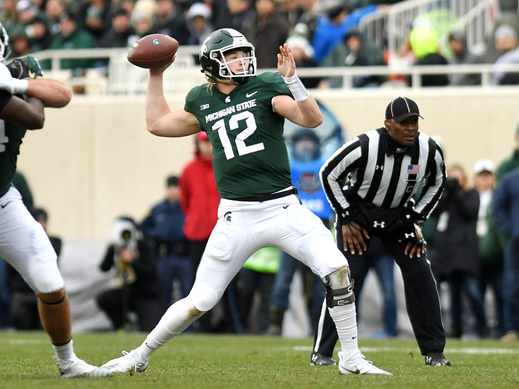 Michigan State's Rocky Lombardi throws a pass during the second quarter on Saturday, Oct. 27, 2018, at Spartan Stadium in East Lansing.