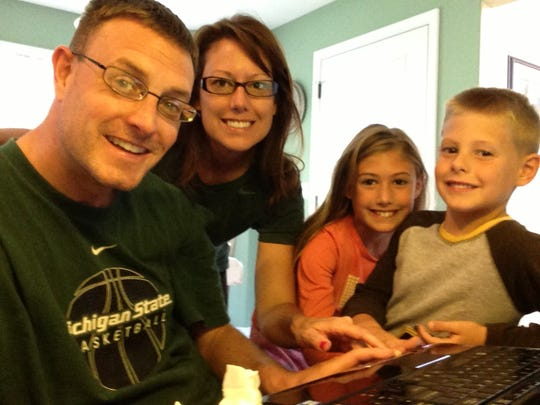 Jeremy Sampson and his family - wife Gena, daughter Grace, then 9, and son CJ, then 7 – take a selfie in 2013 as they hit send on their application to the National Premier Development League to have Lansing United begin as an expansion team.