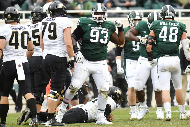 Michigan State's Naquan Jones celebrates after a sack during the second quarter on Saturday, Oct. 27, 2018, at Spartan Stadium in East Lansing.