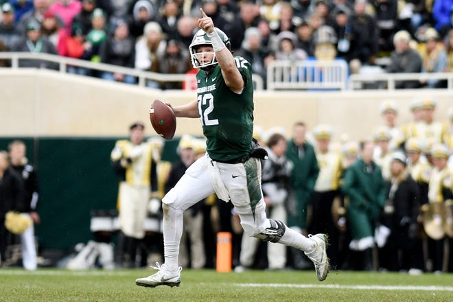 Michigan State's quarterback Rocky Lombardi signals to a receiver during the fourth quarter on Saturday, Oct. 27, 2018, at Spartan Stadium in East Lansing.