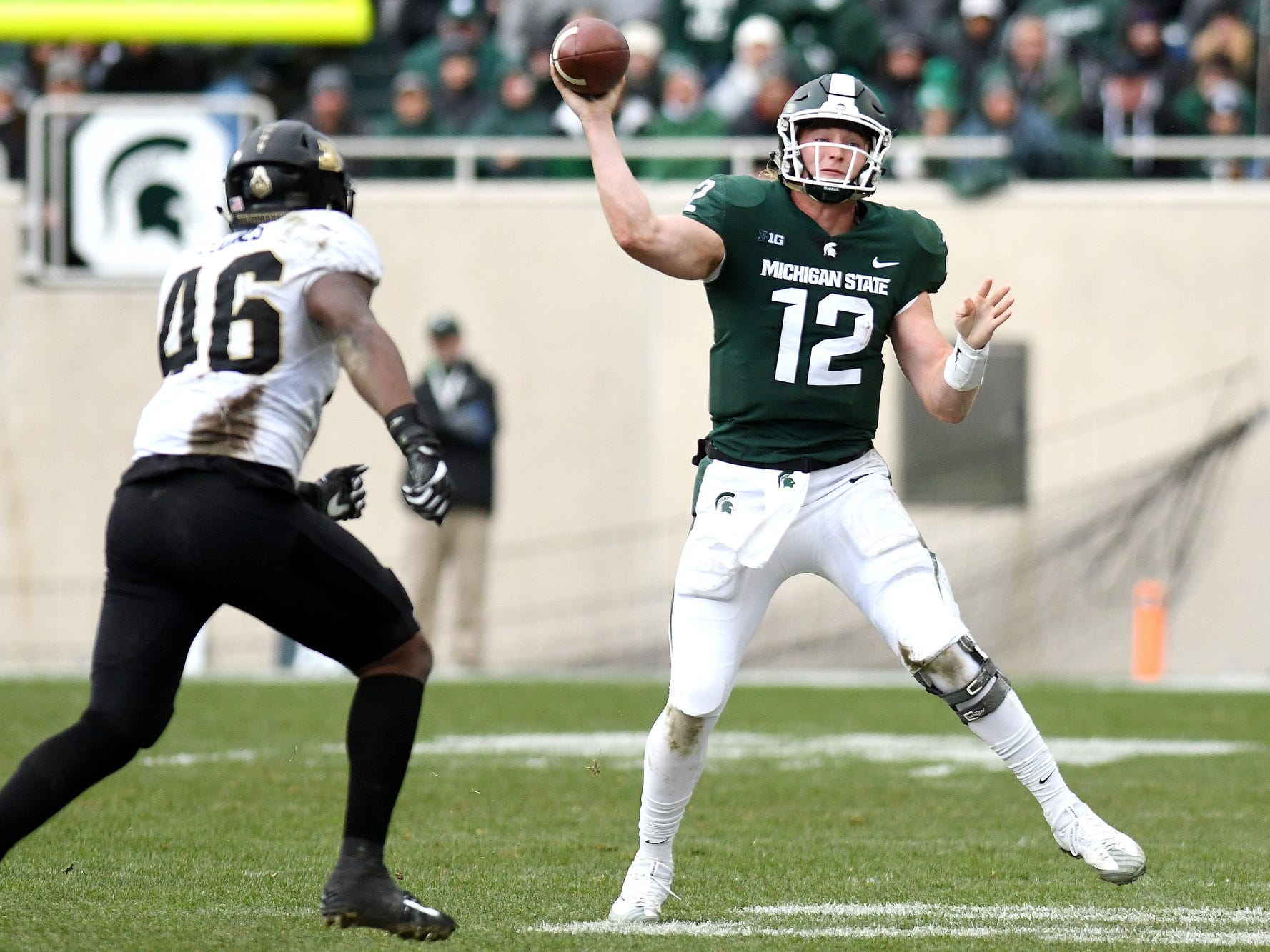 Michigan State's Rocky Lombardi, right, throws the ball as Purdue's Cornel Jones closes in during the third quarter on Saturday, Oct. 27, 2018, at Spartan Stadium in East Lansing.