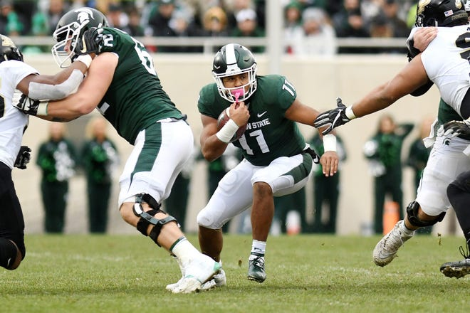 Michigan State's Connor Heyward runs for a gain during the second quarter on Saturday, Oct. 27, 2018, at Spartan Stadium in East Lansing.