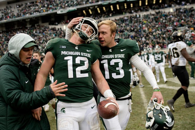 Michigan State's quarterback Rocky Lombardi, left, celebrates with teammate Mickey Macius after the Spartans 23-13 win over Purdue on Saturday, Oct. 27, 2018, at Spartan Stadium in East Lansing.