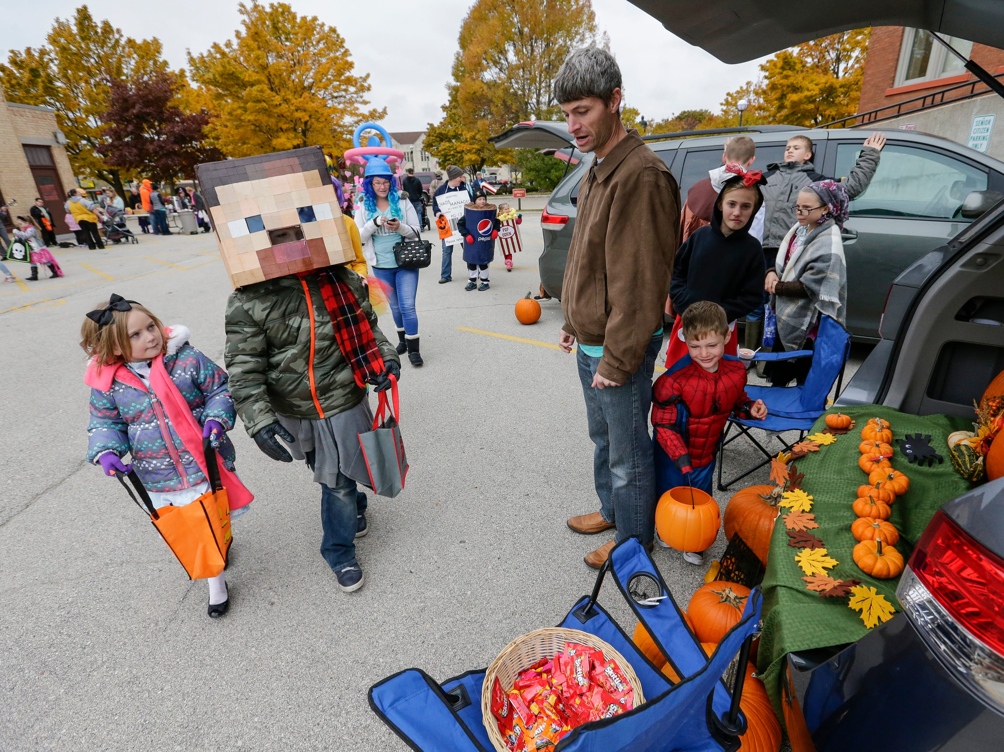 Trick or treaters make their way from car to car during Trunk or Treat Saturday, October 27, 2018, in Two Rivers, Wis. Joshua Clark/USA TODAY NETWORK-Wisconsin