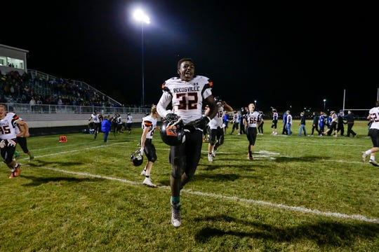Reedsville's Shaun Thomas celebrates the Panther's win over Hilbert in a WIAA division 7 football playoff at Hilbert High School Friday, October 26, 2018, in Hilbert, Wis. The Panthers defeated the Wolves 31-14 to advance to the next round of playoffs. Joshua Clark/USA TODAY NETWORK-Wisconsin