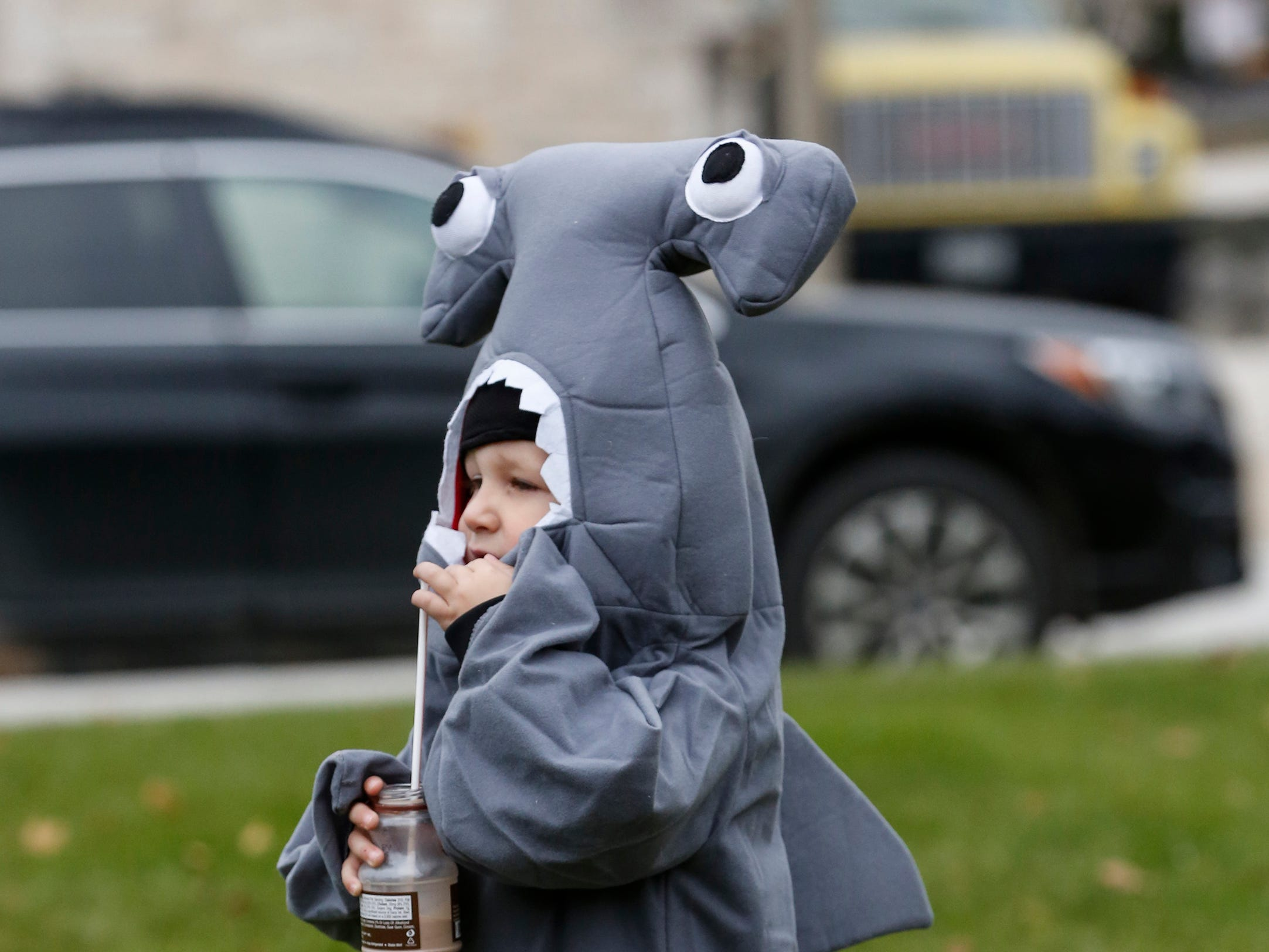 Ryder Hultgren, 4, dressed as a shark during Downtown Trick or Treat Saturday, October 27, 2018, in Two Rivers, Wis. Joshua Clark/USA TODAY NETWORK-Wisconsin