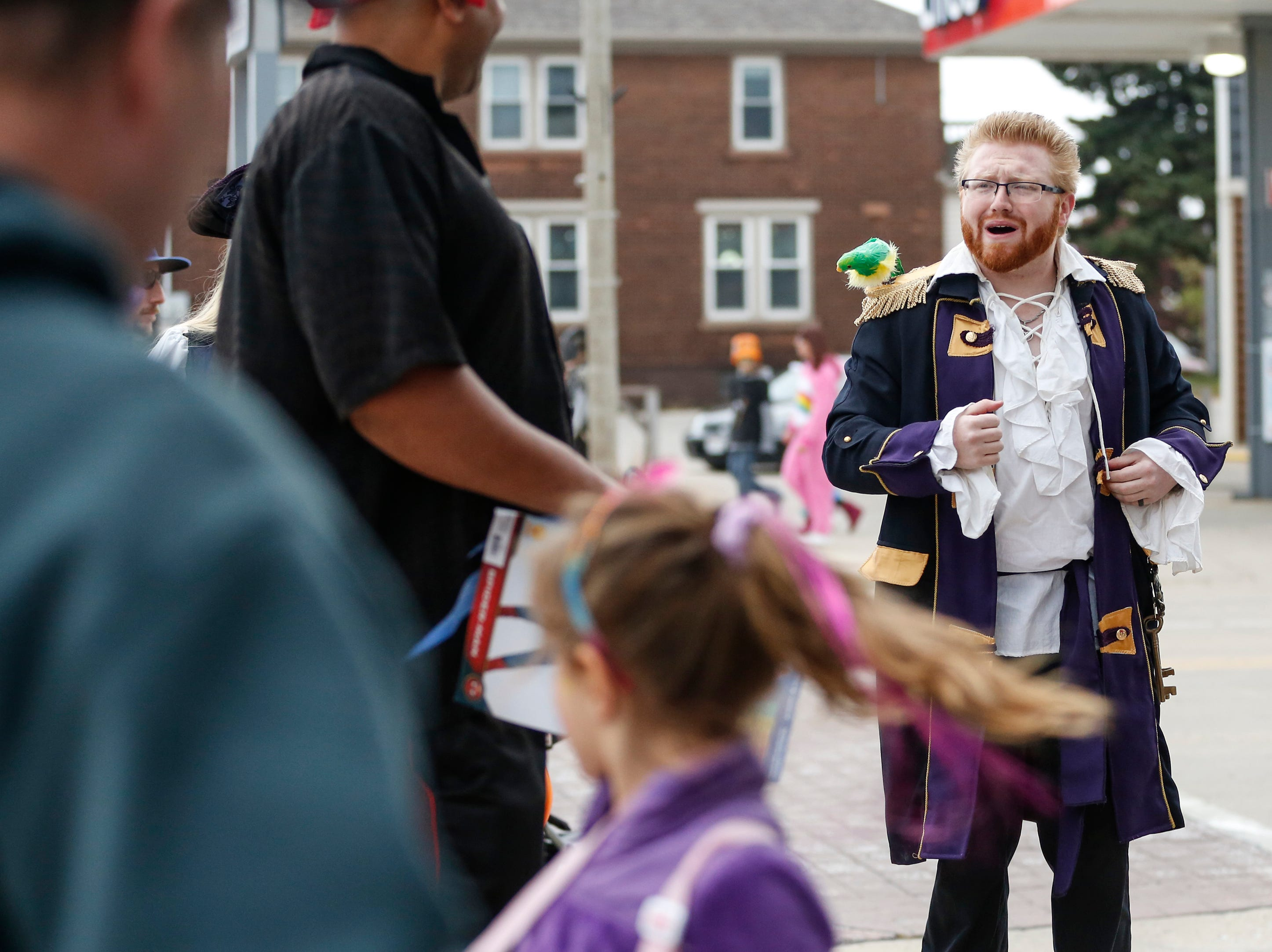 Shaughn Van Ginkel ushers people into the Two Rivers Clothing Company in his best pirate impression to get their treats during Downtown Trick or Treat Saturday, October 27, 2018, in Two Rivers, Wis. Joshua Clark/USA TODAY NETWORK-Wisconsin