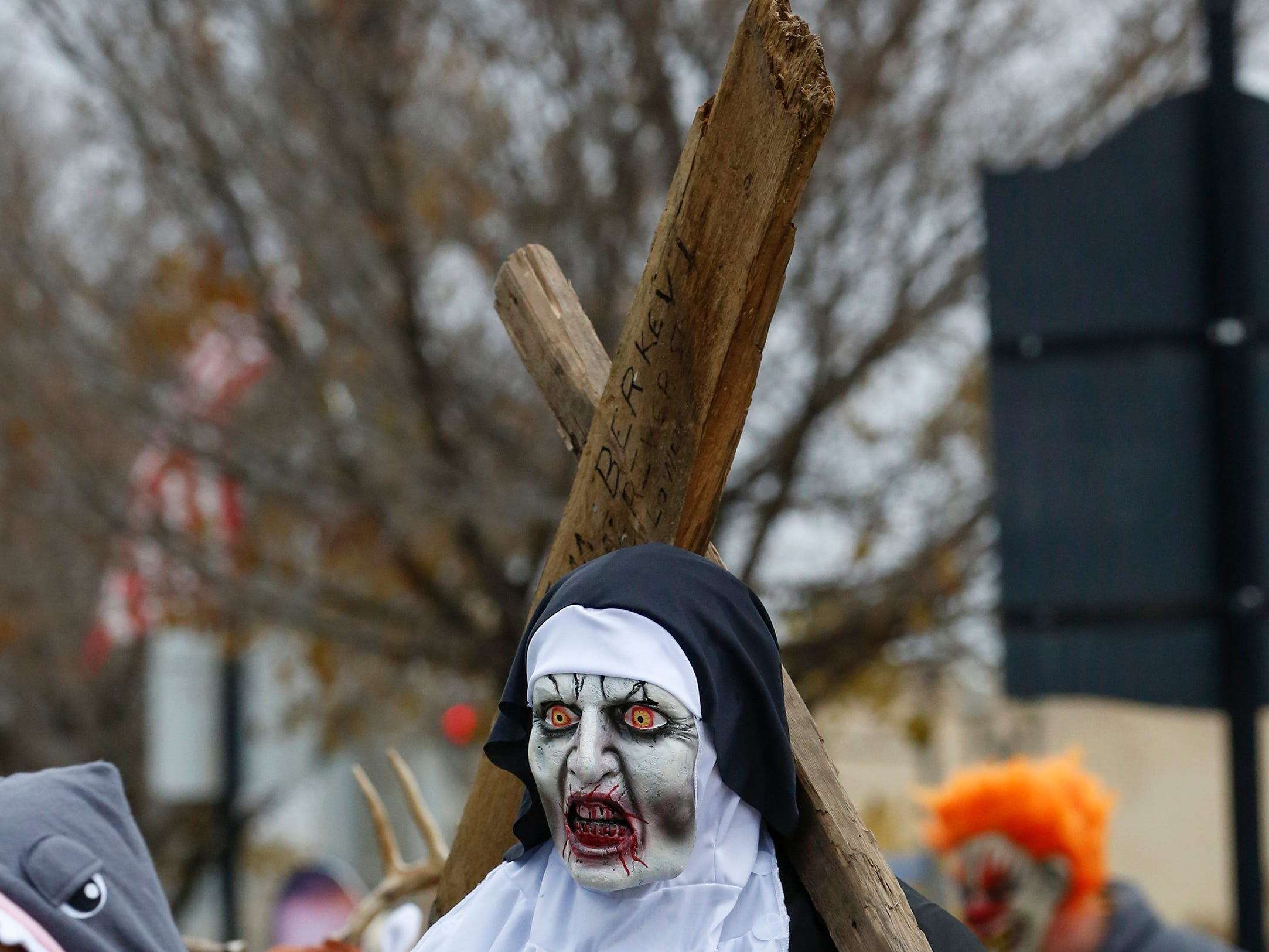 Jimmy Berkevich, of Beaver Dam, walks around as a scary nun during Downtown Trick or Treat Saturday, October 27, 2018, in Two Rivers, Wis. Joshua Clark/USA TODAY NETWORK-Wisconsin