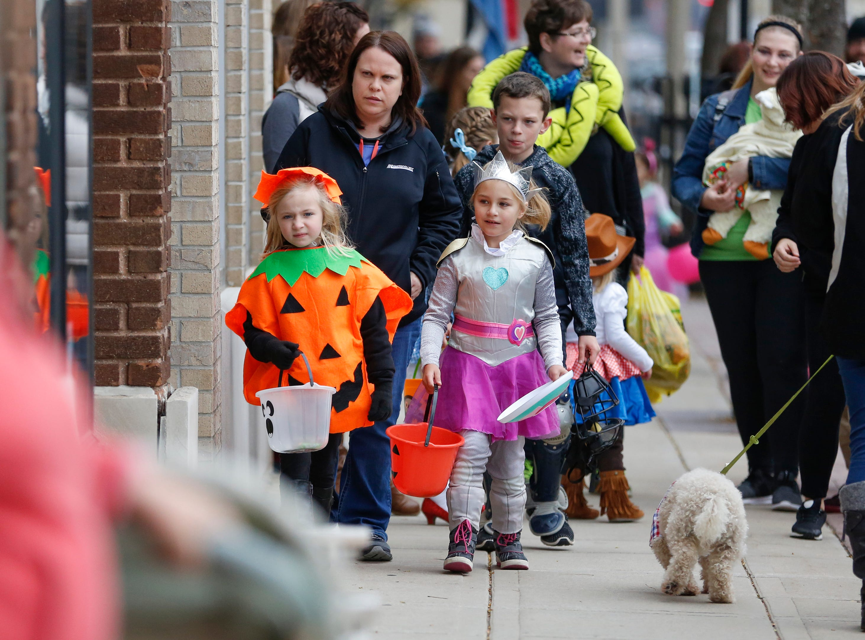Trick or treaters make their way down Washington Street during Downtown Trick or Treat Saturday, October 27, 2018, in Two Rivers, Wis. Joshua Clark/USA TODAY NETWORK-Wisconsin