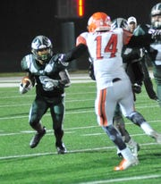 Madison's Miles Bond runs with the ball while playing against Mansfield Senior on Friday evening.