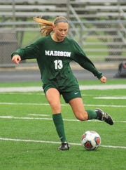 Madison's Talyor Huff kicks the ball down the field while playing against Onatrio on Saturday afternoon.