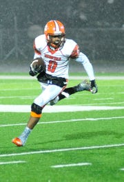Mansfield Senior's Angelo Grose runs with the ball while playing at Madison on Friday evening.