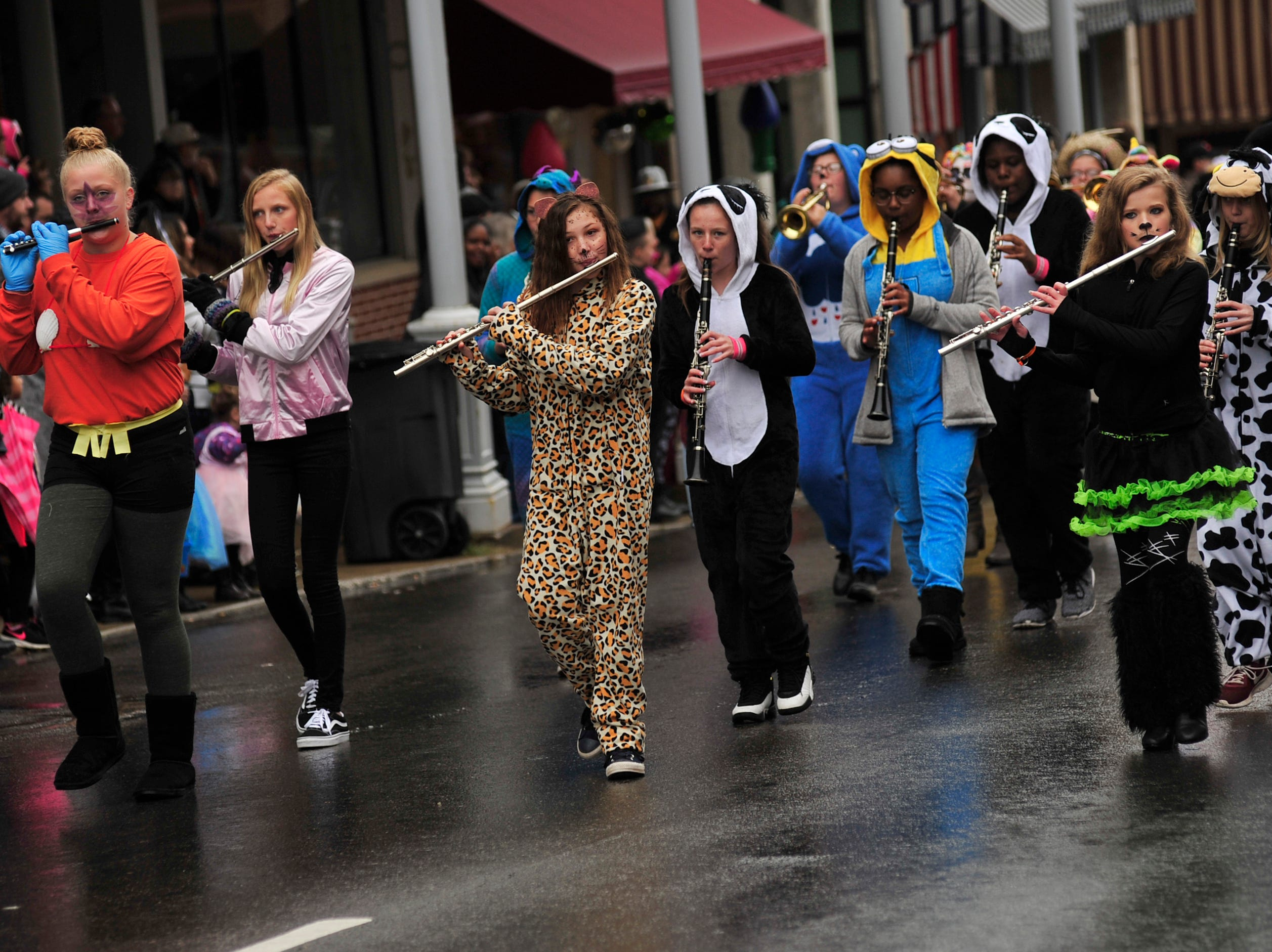Member of the Mansfield Tygers marching band play while in the Halloween Parade down Main Street on Saturday afternoon.