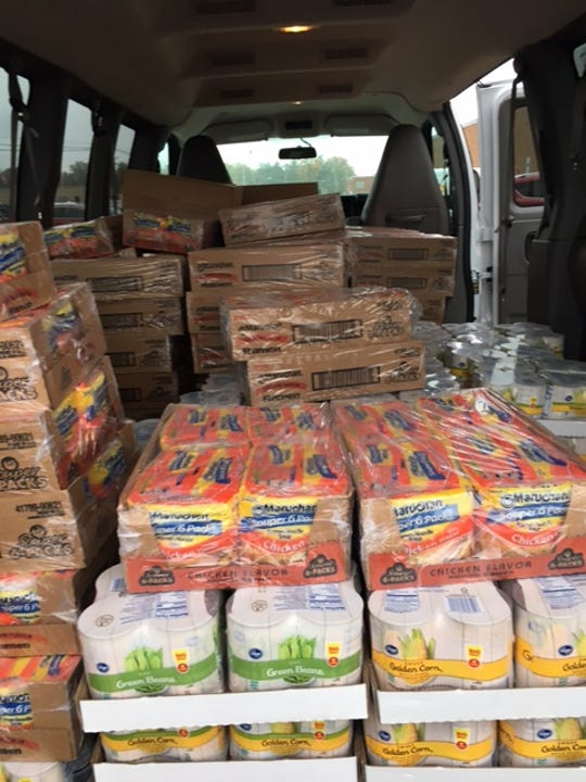 This large commercial van was filled with food items from Kroger's after members of the local Owls Nest donated $1,000 to the Make A Difference Day food drive this weekend for six area food pantries.