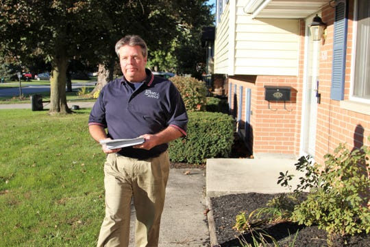 Mark Russell campaigns door to door at Garden Place in the race for judge in Marion County.
