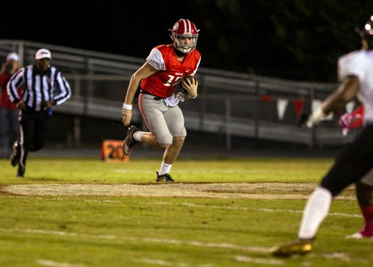 Germantown quarterback Ethan Payne (12) runs ball during game game against Whitehaven Friday October 26, 2018.