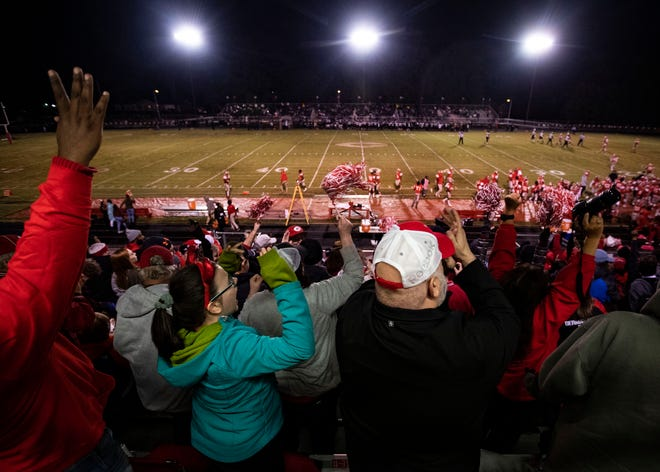 Germantown Devil fans cheer on their  team after at touchdown during the second half of the game against Whitehaven Friday October 26, 2018.