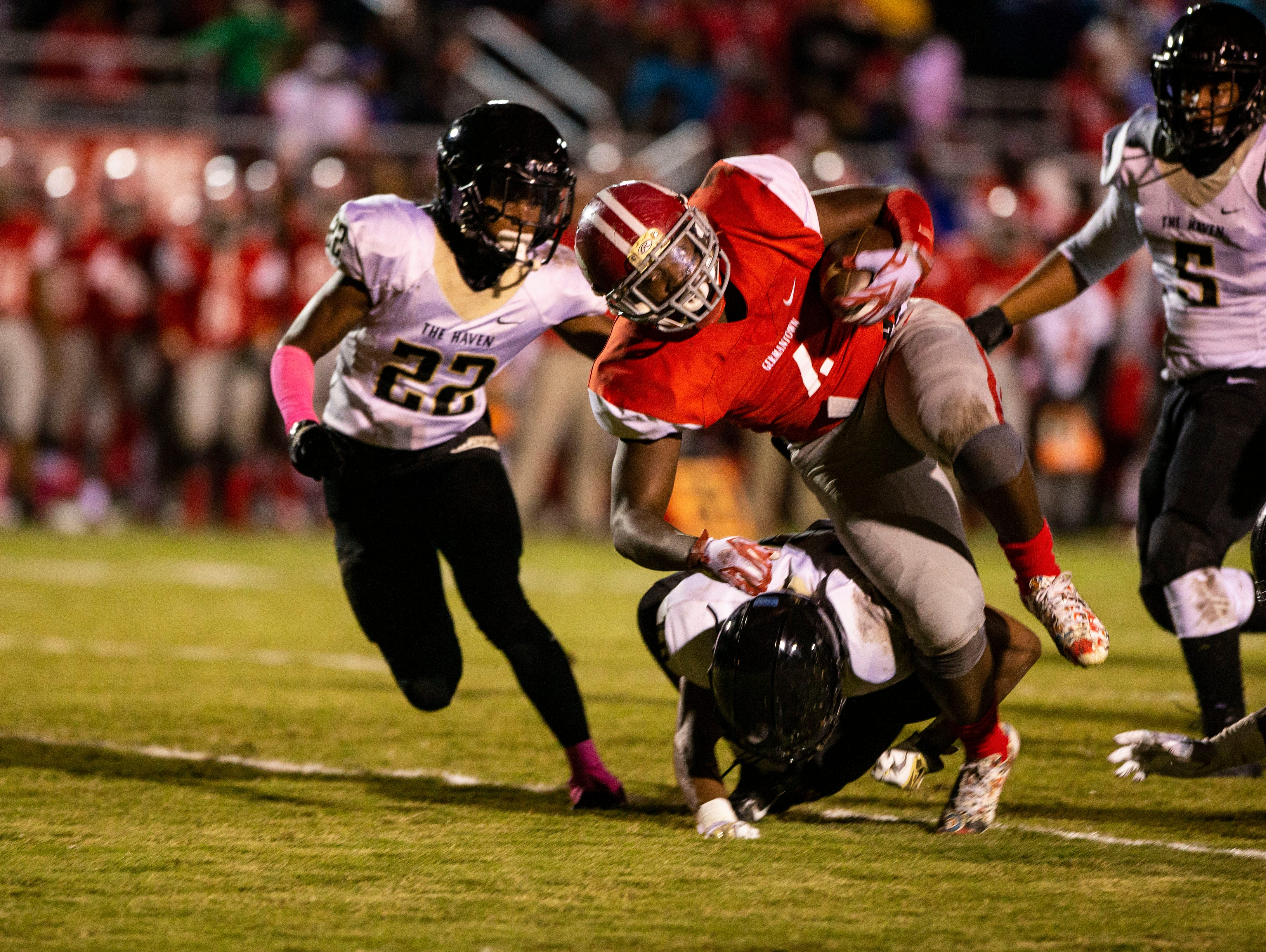 Germantown Devils running back  Eric Foster (4) runs the ball during the football game between the Germantown Devils and the Whitehaven Tigers Friday October 26, 2018.