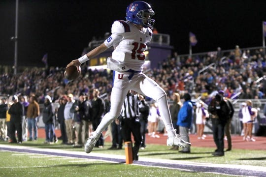 Memphis University School's Sellers Shy leaps in the endzone scoring a touchdown at CBU on Friday, Oct. 26, 2018.
