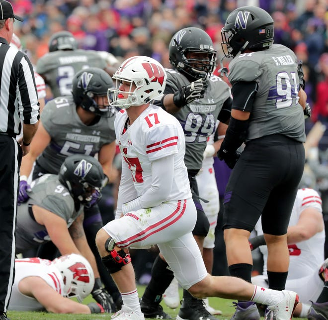UW quarterback Jack Coan gets up after losing a fumble against Northwestern at the 13-yard line of the Badgers during the second half on Saturday in Evanston, Ill.