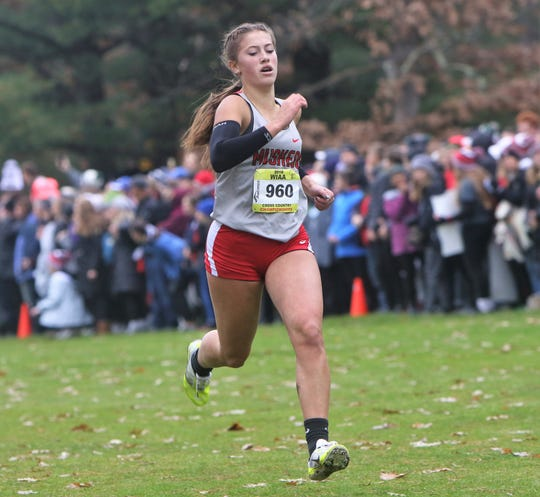 Muskego junior Brittany Helm races down the stretch at the WIAA state cross country meet at Ridges Golf Course in Wisconsin Rapids.