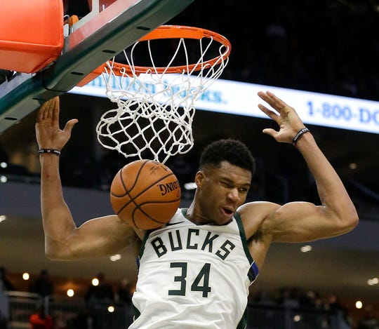 "Milwaukee Bucks forward Giannis Antetokounmpo dunks Oct. 24, 2018, in Milwaukee. A local musician has written a song inspired by the ""Greek Freak."""
