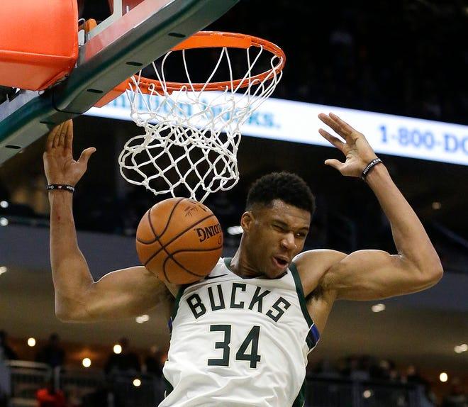 Giannis Antetokounmpo dunks Oct. 24, 2018, in Milwaukee.