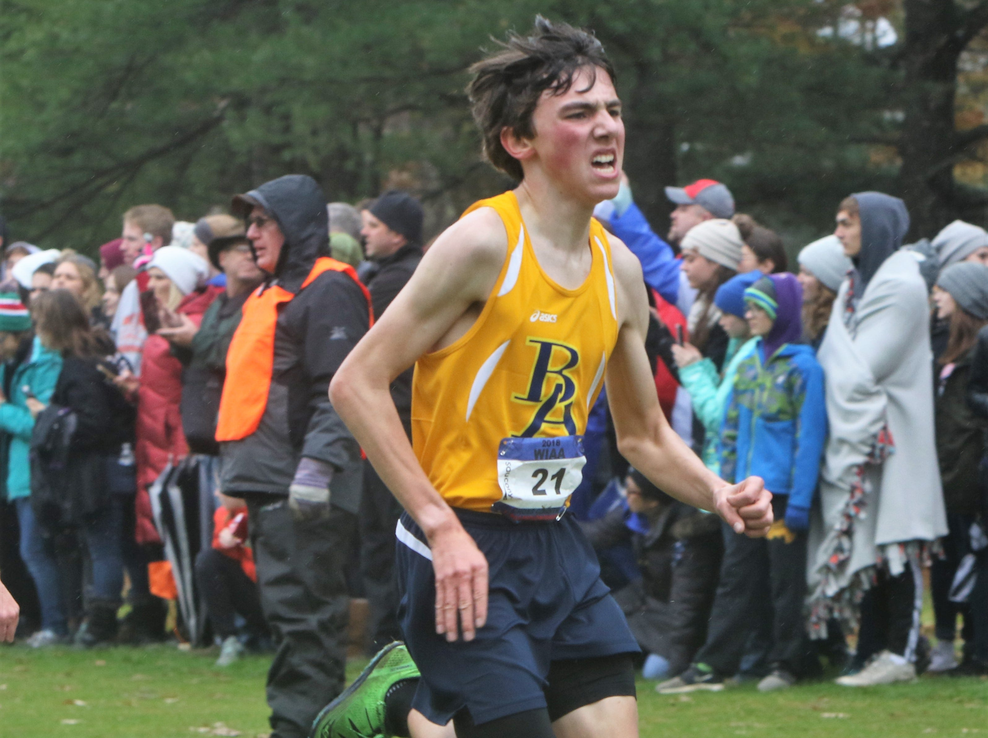 Brookfield Academy freshman Nathaniel Osborne sprints toward the finish line at the WIAA state cross country meet at Ridges Golf Course in Wisconsin Rapids.