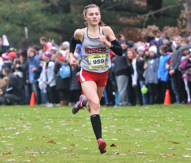 Muskego sophomore Kate Sperka races toward the finish line en route to a second-place finish at the WIAA state cross country meet at Ridges Golf Course Saturday in Wisconsin Rapids.