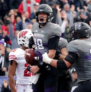 Northwestern quarterback Clayton Thorson celebrates a touchdown in the first half Saturday.