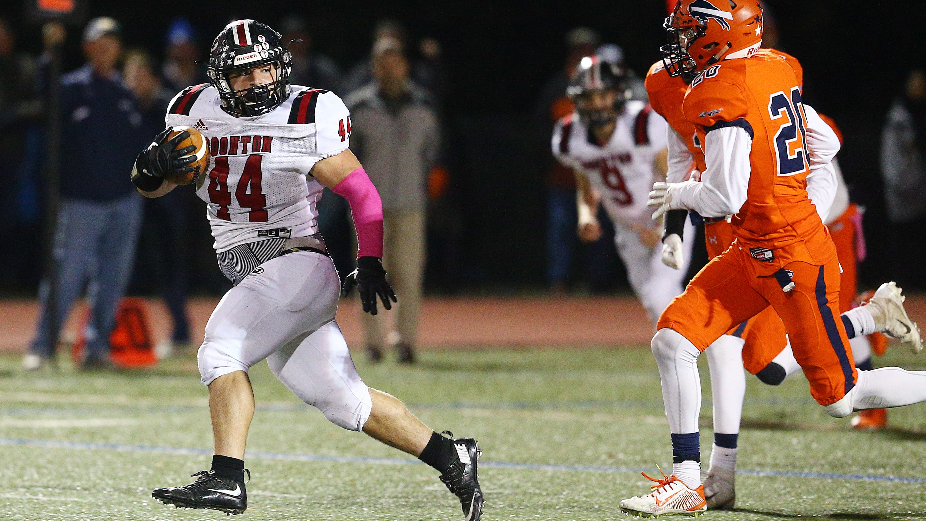 Boonton fullback Joseph Cannizzaro gains major yardage vs. Mountain Lakes during their SFC American Blue Friday night football game. The Bombers won 42-14 to win the division. October 26, 2018, Mountain Lakes, NJ