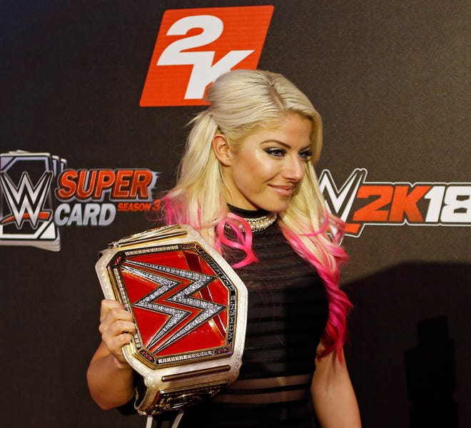 FILE - In this Aug. 18, 2017, file photo, WWE Superstar Alexa Bliss is seen at the WWE 2K18 SummerSlam Kickoff Event in New York. Bliss ditched her skimpy two-piece ring gear that helped make the former WWE champ one of the more alluring wrestlers in the company for a full bodysuit. Performing for the first time in the United Arab Emirates, where strict rules apply to how much of the body a woman can bare in public, Bliss wasn't about to risk offending a nation that was set to have WWE female wrestlers fight on the same card as the men. (Adam Hunger/Invision for 2K Games/AP Images)