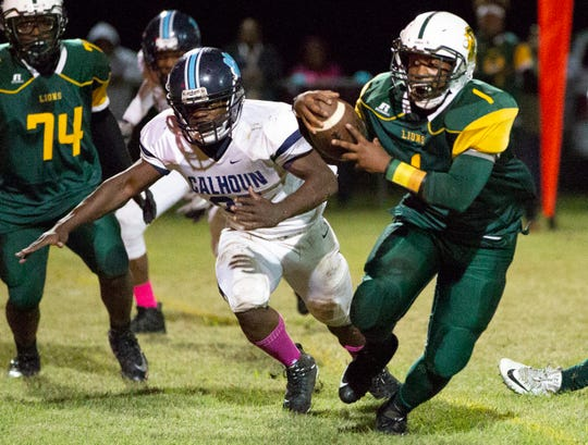 Central's Daylan Preyear runs the ball as Calhoun's Tyrese Seawright remains on his heels.