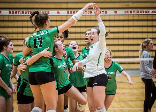 New Castle celebrates their semi state win over New Prairie at Huntington North High School Saturday, Oct. 27, 2018.