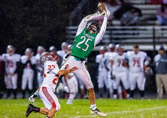 Yorktown's Austin Hill catches against Mississinewa's defense during their game at Yorktown High School Friday, Oct. 26, 2018.