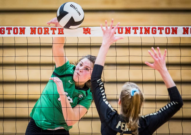 Yorktown's Ellie Miller hits against Penn's defense during their semi state game at Huntington North High School Saturday, Oct. 27, 2018.