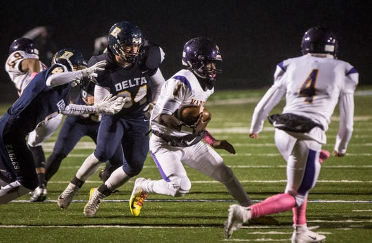 Delta's Brady Pease (34) chases down the ball carrier in a sectional loss to Marion on Friday, Oct. 26, 2018.