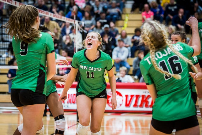 New Castle's Caitlin Shunneson (11) celebrates a point with her teammates during a semistate win over New Prairie.