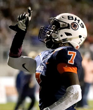 Blackman's Micaleous Elder celebrates one of his three receiving touchdowns during Friday's 41-0 win over Riverdale.