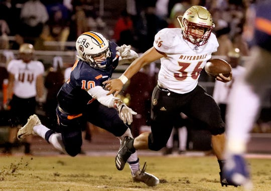 Riverdale's Drew Smith (36) runs the ball as Blackman's Matthew Hall (10) tries to tackle Smith during a game at Blackman High School on Friday, Oct. 26, 2018.