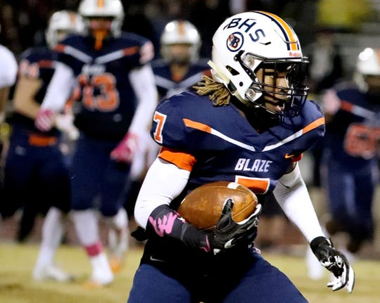 Blackman's Michaleous Elder (7) runs the ball against Riverdale during a game at Blackman High School on Friday, Oct. 26, 2018.