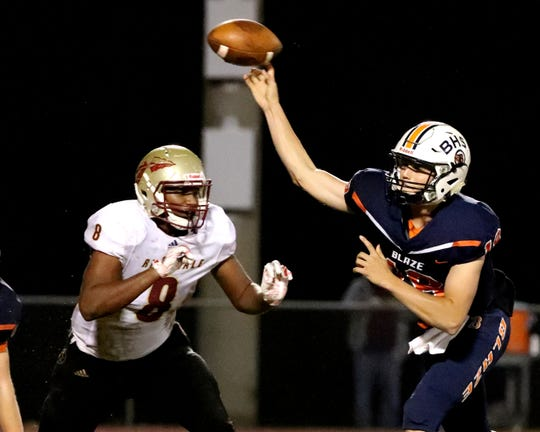 Blackman's quarterback Drew Beam (18) passes the ball as Riverdale's Javon Nelson (8) puts on the pressure at Blackman High School on Friday, Oct. 26, 2018.