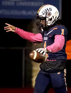Blackman's Adonis Otey (1) celebrates a touchdown against Riverdale at Blackman High School on Friday, Oct. 26, 2018.